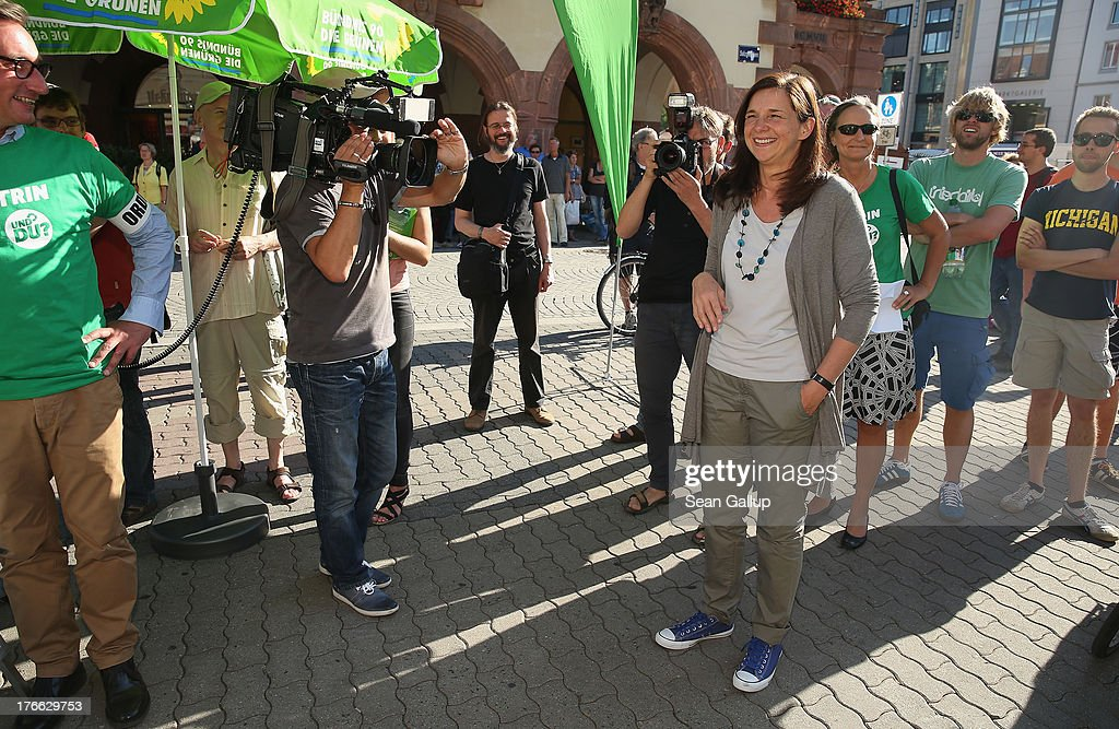 German Greens Party (Buendnis 90/Die Gruenen) co-lead candidate <a gi-track='captionPersonalityLinkClicked' href=/galleries/search?phrase=Katrin+Goering-Eckardt&family=editorial&specificpeople=5335700 ng-click='$event.stopPropagation()'>Katrin Goering-Eckardt</a> campaigns in the city center during an election campaign stop on August 16, 2013 in Leipzig, Germany. Germany is scheduled to hold federal elections on September 22 and the Greens could well play a decisive role in the formation of a government coalition.