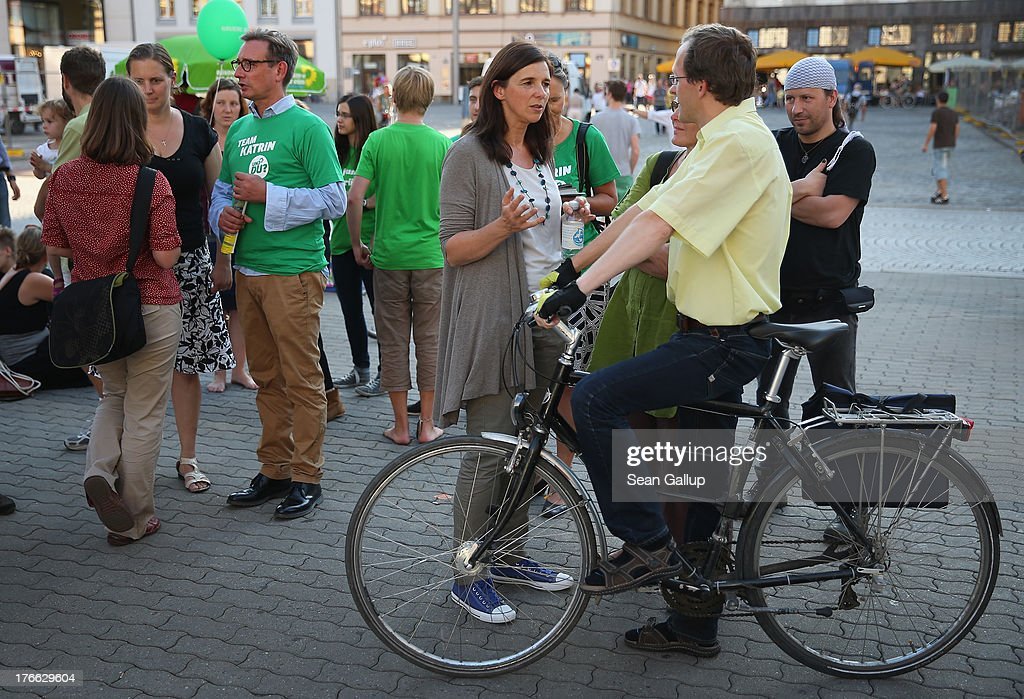 German Greens Party (Buendnis 90/Die Gruenen) co-lead candidate <a gi-track='captionPersonalityLinkClicked' href=/galleries/search?phrase=Katrin+Goering-Eckardt&family=editorial&specificpeople=5335700 ng-click='$event.stopPropagation()'>Katrin Goering-Eckardt</a> (C) chats with passers-by during an election campaign stop on August 16, 2013 in Leipzig, Germany. Germany is scheduled to hold federal elections on September 22 and the Greens could well play a decisive role in the formation of a government coalition.
