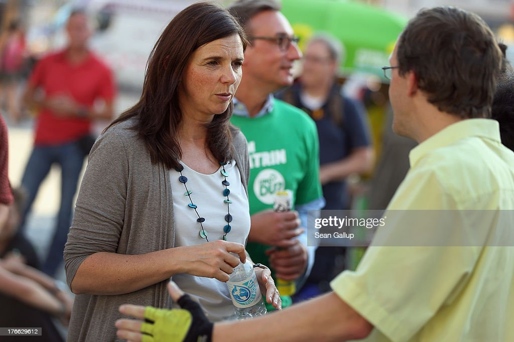 German Greens Party (Buendnis 90/Die Gruenen) co-lead candidate <a gi-track='captionPersonalityLinkClicked' href=/galleries/search?phrase=Katrin+Goering-Eckardt&family=editorial&specificpeople=5335700 ng-click='$event.stopPropagation()'>Katrin Goering-Eckardt</a> chats with passers-by during an election campaign stop on August 16, 2013 in Leipzig, Germany. Germany is scheduled to hold federal elections on September 22 and the Greens could well play a decisive role in the formation of a government coalition.