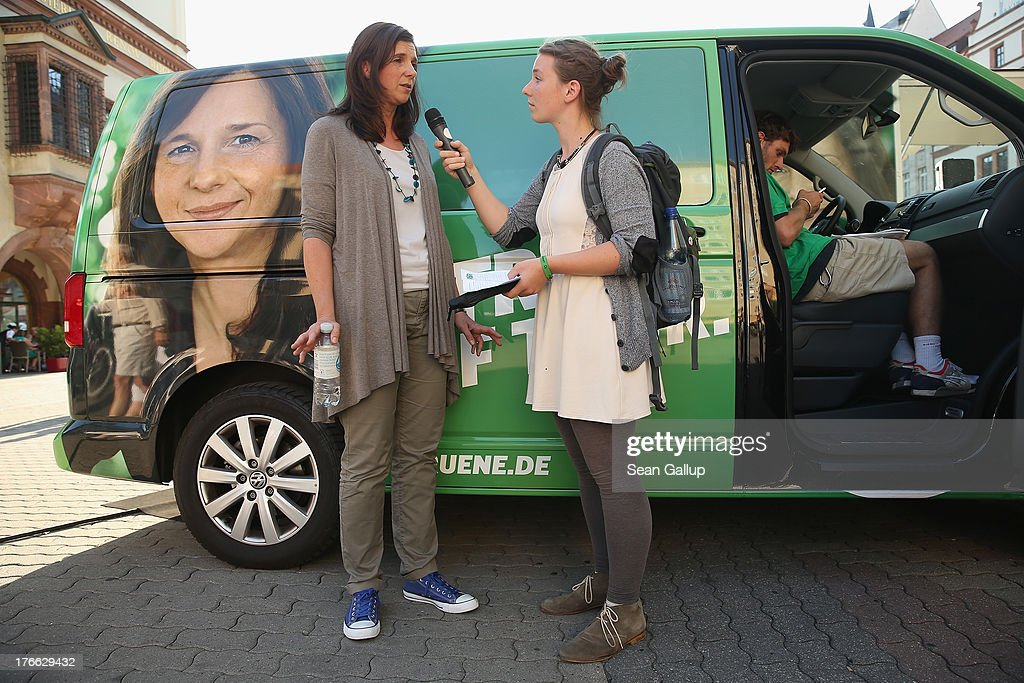 German Greens Party (Buendnis 90/Die Gruenen) co-lead candidate <a gi-track='captionPersonalityLinkClicked' href=/galleries/search?phrase=Katrin+Goering-Eckardt&family=editorial&specificpeople=5335700 ng-click='$event.stopPropagation()'>Katrin Goering-Eckardt</a> speaks to a reporter during an election campaign stop on August 16, 2013 in Leipzig, Germany. Germany is scheduled to hold federal elections on September 22 and the Greens could well play a decisive role in the formation of a government coalition.