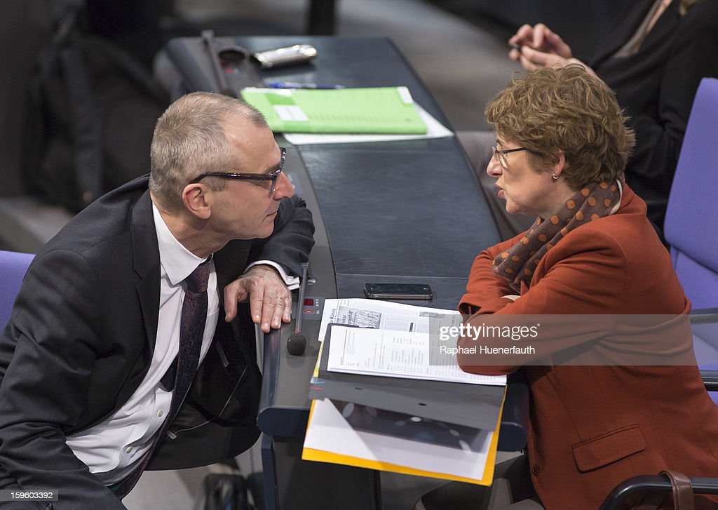 German Greens party politicians Volker Beck (L) and Britta Hasselmann (R) during a debate on the Annual Economic Report 2013 of the Federal Government at Reichstag, the seat of the German Parliament (Bundestag), on January 17, 2013 in Berlin, Germany. German Economics Minister Philipp Roesler warned that a short-term deal with the euro crisis through inflation, stating that it's not 'A price we are not willing to pay - the price of monetary stability' in his inaugural speech to the annual economic report in parliament. Merkel's Christian Democratic Union (CDU) will face an electoral test this Sunday as voters go to the polls in Lower Saxony.