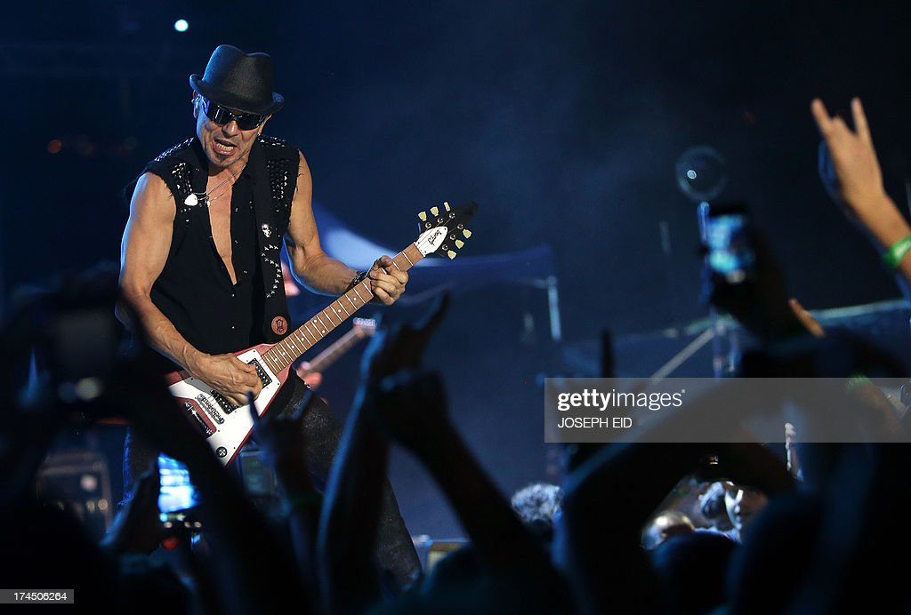 German guitarist and founding member of heavy metal band Scorpions, Rudolf Schenker, performs on stage during a concert as part of the Byblos music festival in the coastal town of Byblos, north of Beirut, late on July 26, 2013.