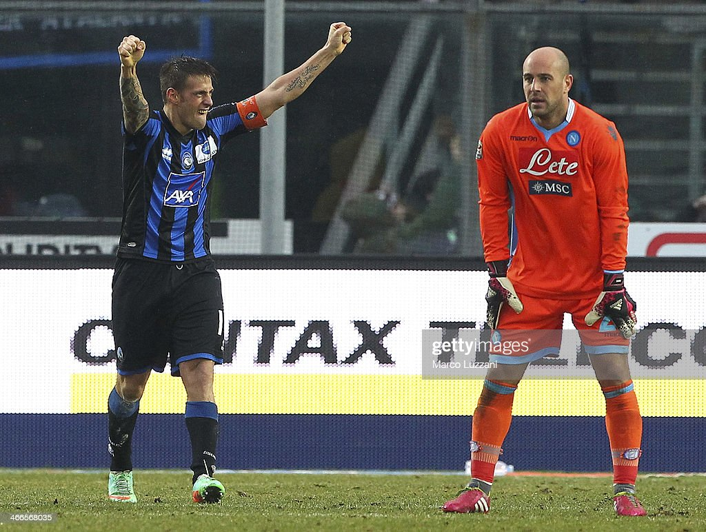 German Gustavo Denis (L) of Atalanta BC celebrates after scoring his second goal as goalkeeper Pepe Reina of SSC Napoli looks on during the Serie A match between Atalanta BC and SSC Napoli at Stadio Atleti Azzurri d'Italia on February 2, 2014 in Bergamo, Italy.