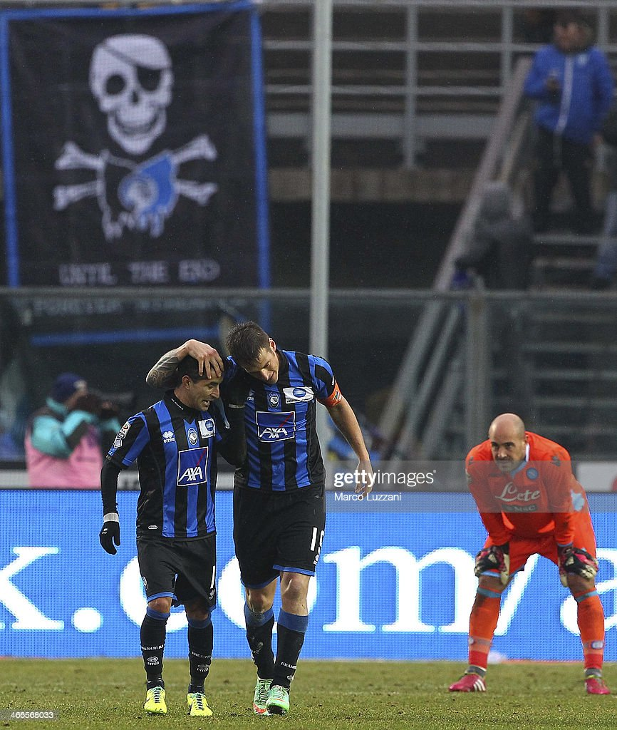 German Gustavo Denis (C) of Atalanta BC celebrates his second goal with team-mate Maximiliano Moralez (L) as goalkeeper Pepe Reina of SSC Napoli looks on during the Serie A match between Atalanta BC and SSC Napoli at Stadio Atleti Azzurri d'Italia on February 2, 2014 in Bergamo, Italy.