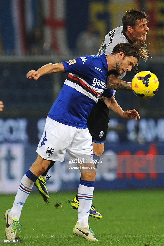 German Gustavo Denis (R) of Atalanta BC clashes with Paolo Castellini of UC Sampdoria during the Serie A match between UC Sampdoria and Atalanta BC at Stadio Luigi Ferraris on October 26, 2013 in Genoa, Italy.