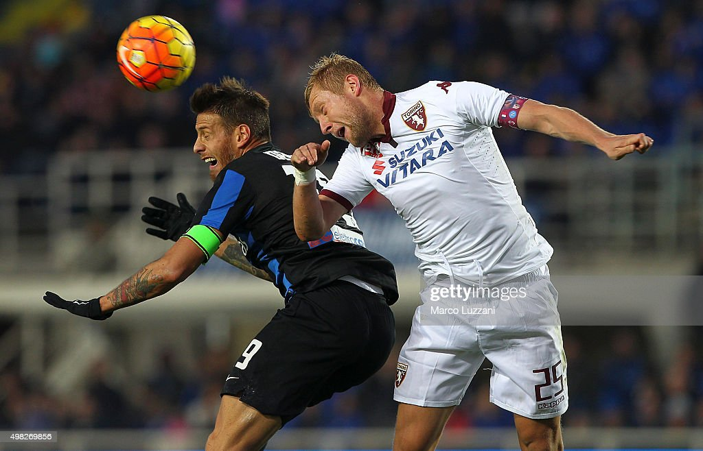 German Gustavo Denis of Atalanta BC competes for the ball with Kamil Glik of Torino FC during the Serie A match between Atalanta BC and Torino FC at Stadio Atleti Azzurri d'Italia on November 22, 2015 in Bergamo, Italy.