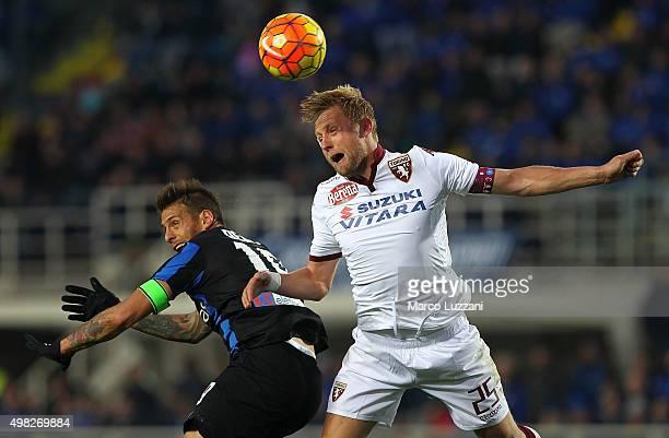 German Gustavo Denis of Atalanta BC competes for the ball with Kamil Glik of Torino FC during the Serie A match between Atalanta BC and Torino FC at...