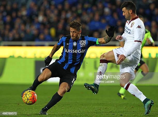 German Gustavo Denis of Atalanta BC is challenged by Cesare Bovo of Torino FC during the Serie A match between Atalanta BC and Torino FC at Stadio...