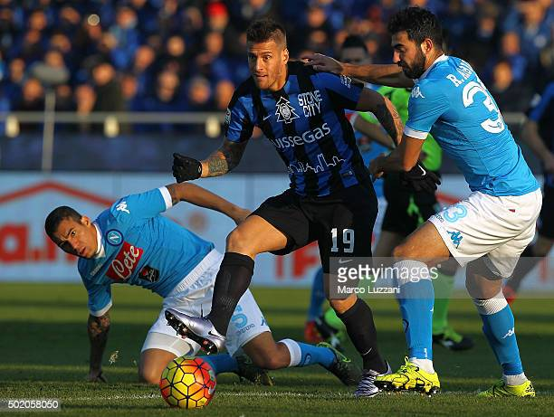 German Gustavo Denis of Atalanta BC is challenged by Raul Albiol of SSC Napoli during the Serie A match between Atalanta BC and SSC Napoli at Stadio...