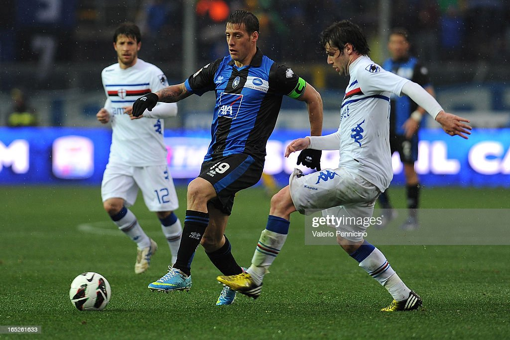 German Gustavo Denis (L) of Atalanta BC turns <a gi-track='captionPersonalityLinkClicked' href=/galleries/search?phrase=Andrea+Poli&family=editorial&specificpeople=4520865 ng-click='$event.stopPropagation()'>Andrea Poli</a> of UC Sampdoria during the Serie A match between Atalanta BC and UC Sampdoria at Stadio Atleti Azzurri d'Italia on March 30, 2013 in Bergamo, Italy.