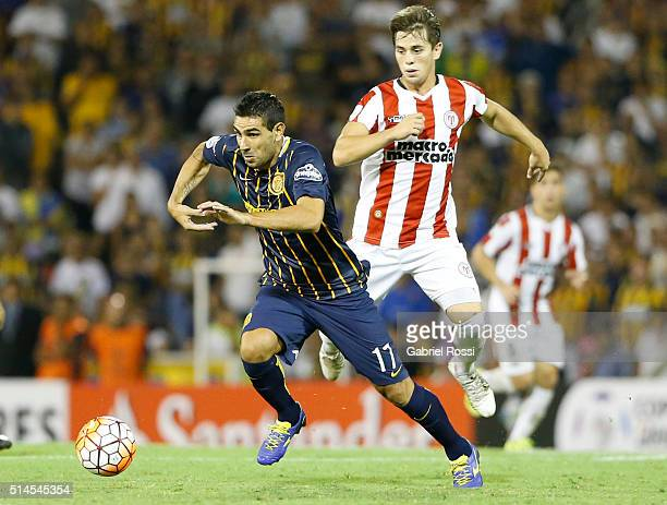German Gustavo Herrera of Rosario Central fights for the ball with Pablo Gonzalez of River Plate during a match between Rosario Central and River...