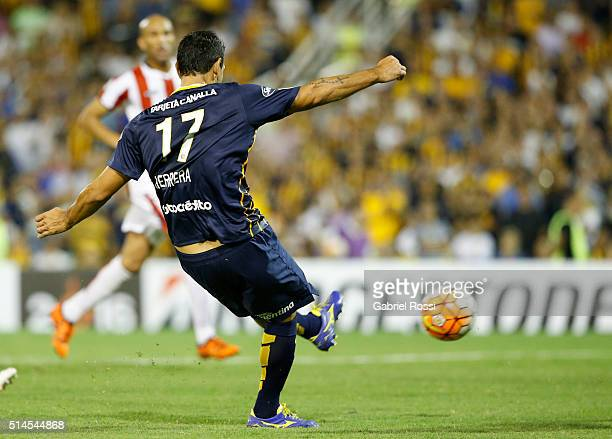 German Gustavo Herrera of Rosario Central shoots to score the second goal of his team during a match between Rosario Central and River Plate as part...
