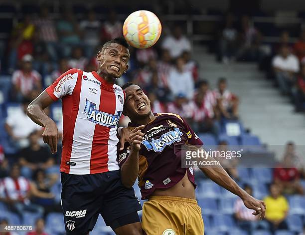 German Gutierrez of Colombia's Junior vies for the ball with Andres Ibarguen of Colombia's Tolima during their 2015 Sudamericana Cup football match...