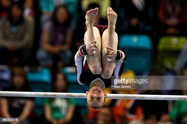 German gymnast Maike Roll performs on the uneven bars at the German individual championship during the German Gymnastics Festival at the...