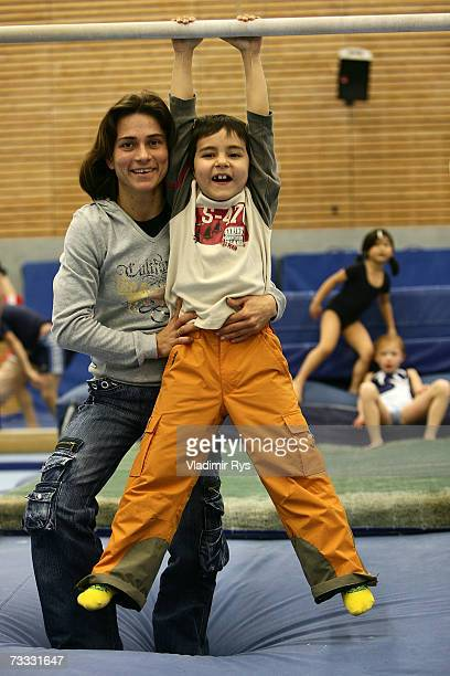 German gymnast Oksana Chusovitina pose for a photo with her son Alisher prior to the training on December 04 2006 in Cologne Germany