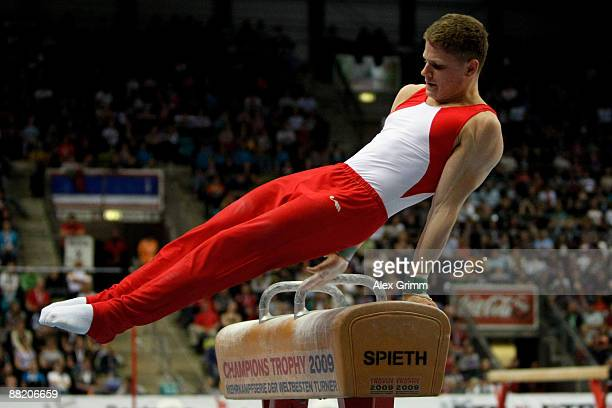German gymnast Philip Sorrer performs on the pommel horse at the German individual championship during the German Gymnastics Festival at the...