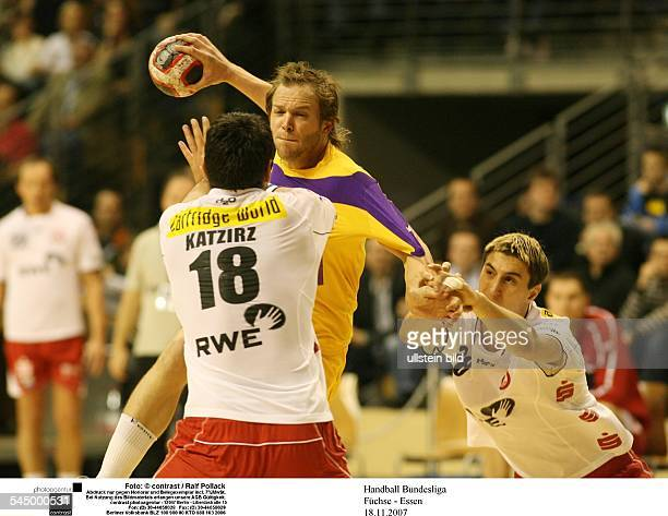 German Handball League Fuechse Berlin TUSEM Essen David Katzirz Alexander Schult holding Kjetil O Strand