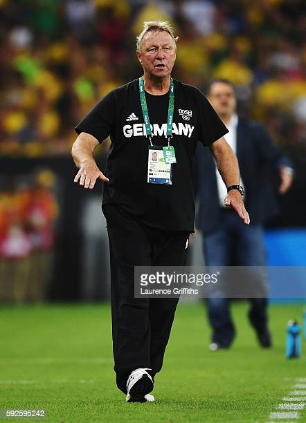 German head coach Horst Hrubesch gives instructions from the touchline during the Men's Football Final between Brazil and Germany at the Maracana...