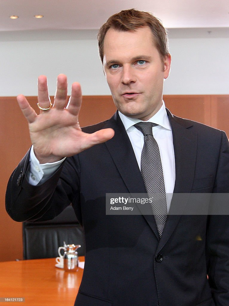 German Health Minister <a gi-track='captionPersonalityLinkClicked' href=/galleries/search?phrase=Daniel+Bahr&family=editorial&specificpeople=7622444 ng-click='$event.stopPropagation()'>Daniel Bahr</a> arrives for the German federal Cabinet meeting on March 20, 2013 in Berlin, Germany. High on the morning's agenda was discussion of proposed laws pertaining to preventative health measures as well as the proposed ban on the right-wing National Democratic Party (Nationaldemokratische Partei Deutschlands, or NPD), which, contrary to a joint bid by Germany's 16 states, the federal government has not supported.