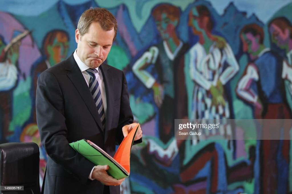 German Health Minister <a gi-track='captionPersonalityLinkClicked' href=/galleries/search?phrase=Daniel+Bahr&family=editorial&specificpeople=7622444 ng-click='$event.stopPropagation()'>Daniel Bahr</a> arrives for the German government weekly cabinet meeting on May 23, 2012 in Berlin, Germany. High on the morning's agenda is a new measure aimed at curbing illegal practices among doctors and health clinics in Germany.