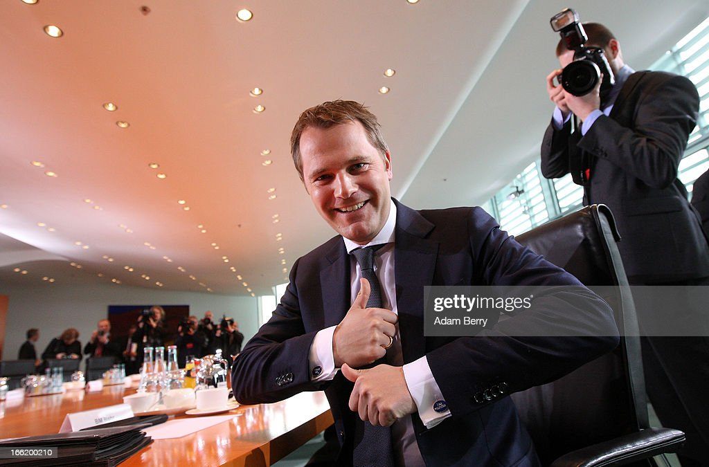 German Health Minister <a gi-track='captionPersonalityLinkClicked' href=/galleries/search?phrase=Daniel+Bahr&family=editorial&specificpeople=7622444 ng-click='$event.stopPropagation()'>Daniel Bahr</a> arrives for the weekly German federal cabinet meeting on April 10, 2013 in Berlin, Germany. High on the morning's agenda was discussion of the federal government's report on the current status of freelance professions in the country, as well as of health insurance policy and legislation on natural medicine.