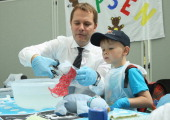 German Health Minister Daniel Bahr assists Noel in preparing a plaster cast for Noel's blue teddy creature Maxeis at the Teddy Bear Clinic at Charite...