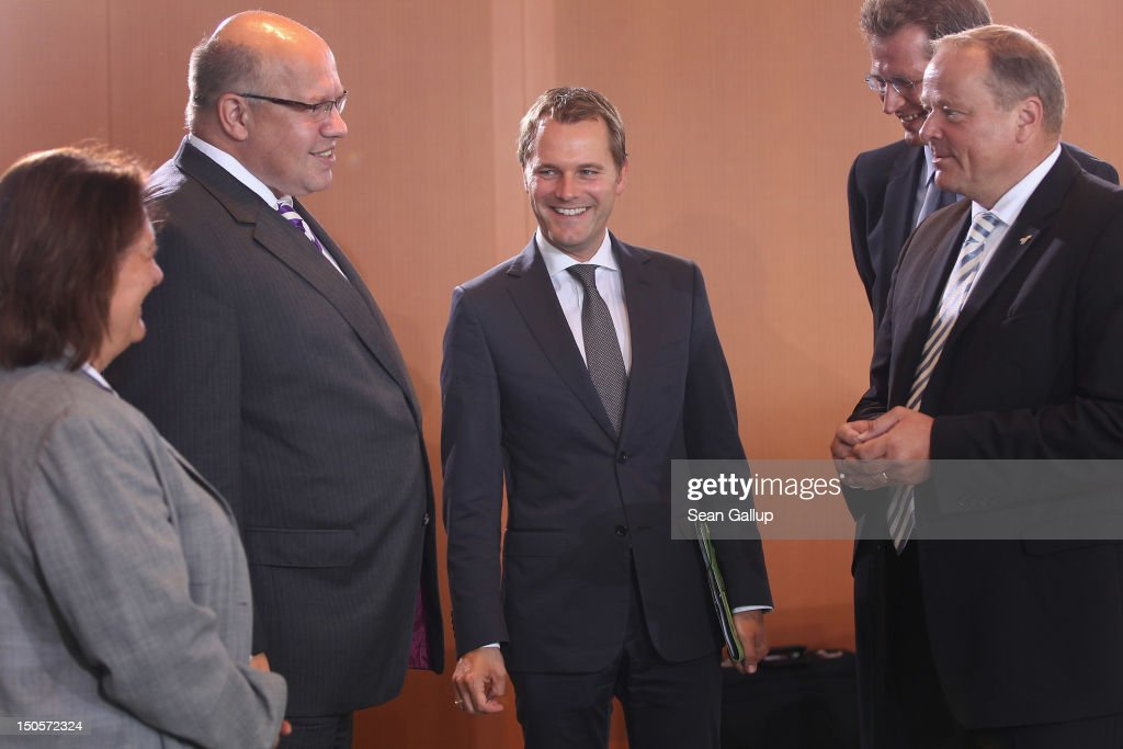 German Health Minister <a gi-track='captionPersonalityLinkClicked' href=/galleries/search?phrase=Daniel+Bahr&family=editorial&specificpeople=7622444 ng-click='$event.stopPropagation()'>Daniel Bahr</a> (C) chats with colleagues as he arrives for the weekly German government cabinet meeting on August 22, 2012 in Berlin, Germany. High on the morning's agenda is a proposed law to encourage precautionary tests for patients to check for signs of certain types of cancer.