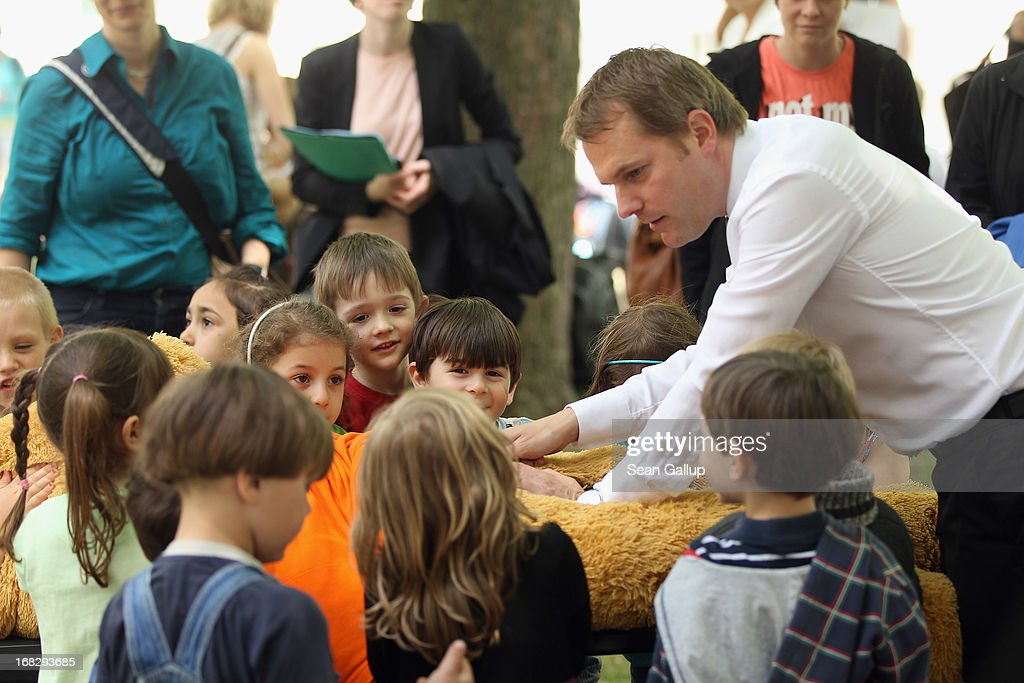 German Health Minister <a gi-track='captionPersonalityLinkClicked' href=/galleries/search?phrase=Daniel+Bahr&family=editorial&specificpeople=7622444 ng-click='$event.stopPropagation()'>Daniel Bahr</a> helps children zip up the belly of a teddy bear after exploring its inner organs at the Teddy Bear Clinic at Charite Hospital on May 8, 2013 in Berlin, Germany. Charite Hospital hosts the annual Teddy Bear Clinic days and invites children from Berlin day care centers to bring their injured teddy bears for fictitious examinations, x-rays, surgery and healing as a way for small children to become acquainted with a medical environment.
