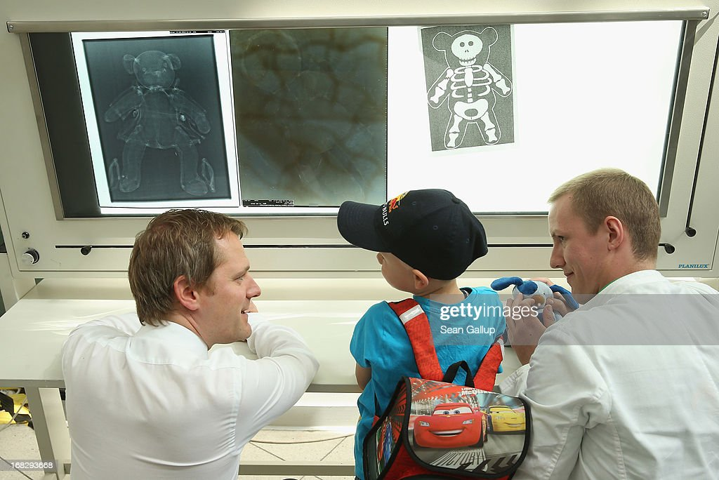 German Health Minister <a gi-track='captionPersonalityLinkClicked' href=/galleries/search?phrase=Daniel+Bahr&family=editorial&specificpeople=7622444 ng-click='$event.stopPropagation()'>Daniel Bahr</a> (L) listens to Noel, 6, after they viewed a fictitious x-ray of Noel's blue teddy creature Maxeis at the Teddy Bear Clinic at Charite Hospital on May 8, 2013 in Berlin, Germany. Charite Hospital hosts the annual Teddy Bear Clinic days and invites children from Berlin day care centers to bring their injured teddy bears for fictitious examinations, x-rays, surgery and healing as a way for small children to become acquainted with a medical environment.