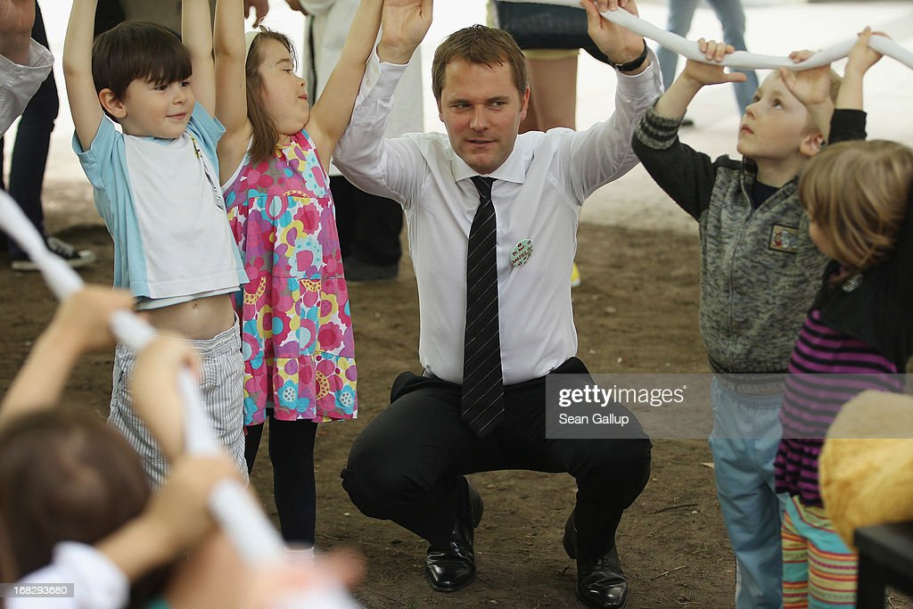 German Health Minister <a gi-track='captionPersonalityLinkClicked' href=/galleries/search?phrase=Daniel+Bahr&family=editorial&specificpeople=7622444 ng-click='$event.stopPropagation()'>Daniel Bahr</a> plays with children at the Teddy Bear Clinic at Charite Hospital on May 8, 2013 in Berlin, Germany. Charite Hospital hosts the annual Teddy Bear Clinic days and invites children from Berlin day care centers to bring their injured teddy bears for fictitious examinations, x-rays, surgery and healing as a way for small children to become acquainted with a medical environment.