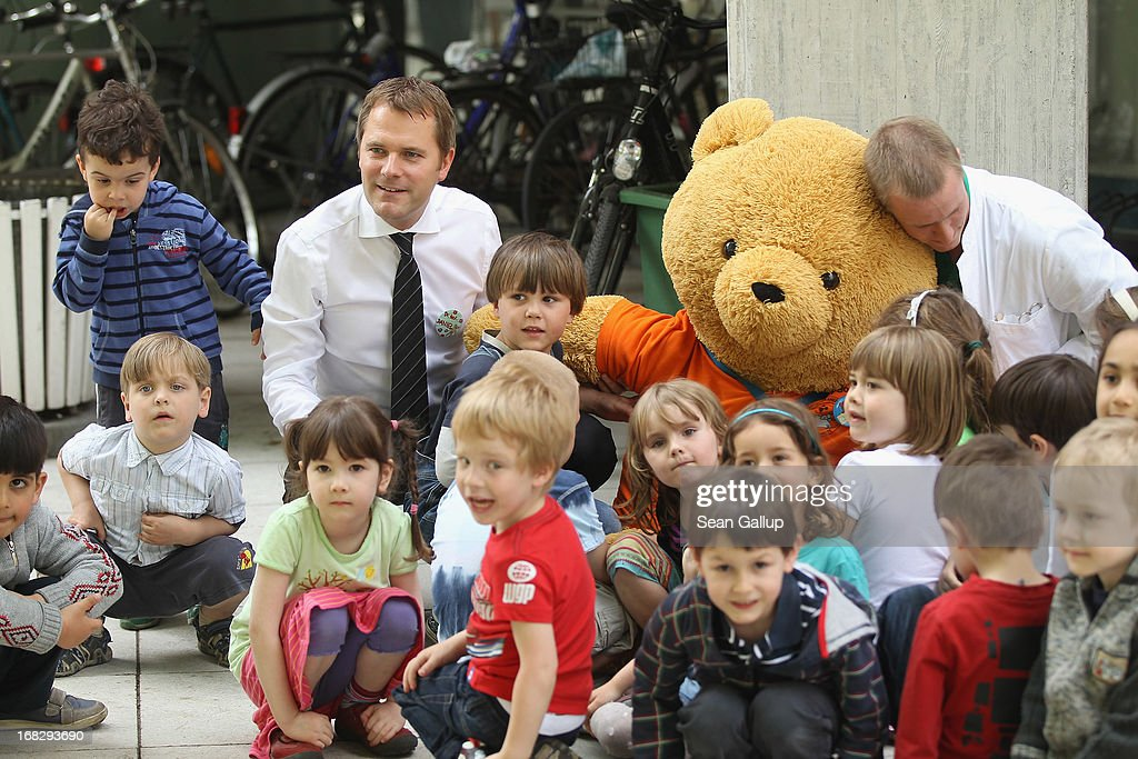 German Health Minister <a gi-track='captionPersonalityLinkClicked' href=/galleries/search?phrase=Daniel+Bahr&family=editorial&specificpeople=7622444 ng-click='$event.stopPropagation()'>Daniel Bahr</a> poses with visiting children and a giant teddy bear at the Teddy Bear Clinic at Charite Hospital on May 8, 2013 in Berlin, Germany. Charite Hospital hosts the annual Teddy Bear Clinic days and invites children from Berlin day care centers to bring their injured teddy bears for fictitious examinations, x-rays, surgery and healing as a way for small children to become acquainted with a medical environment.