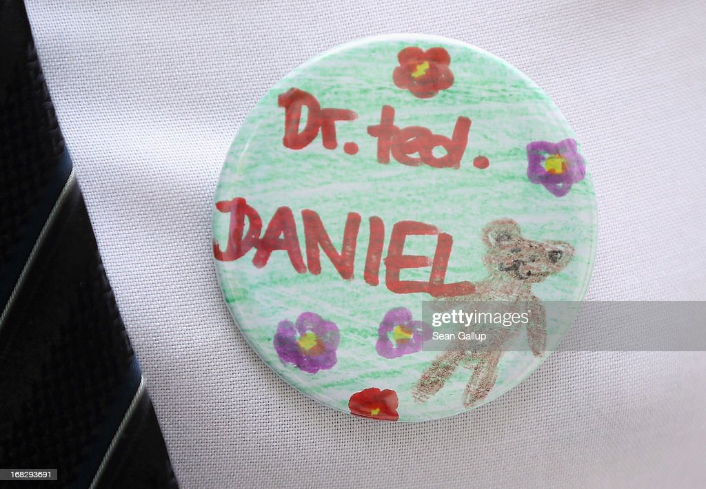 German Health Minister <a gi-track='captionPersonalityLinkClicked' href=/galleries/search?phrase=Daniel+Bahr&family=editorial&specificpeople=7622444 ng-click='$event.stopPropagation()'>Daniel Bahr</a> wears a button while visiting the Teddy Bear Clinic at Charite Hospital on May 8, 2013 in Berlin, Germany. Charite Hospital hosts the annual Teddy Bear Clinic days and invites children from Berlin day care centers to bring their injured teddy bears for fictitious examinations, x-rays, surgery and healing as a way for small children to become acquainted with a medical environment.