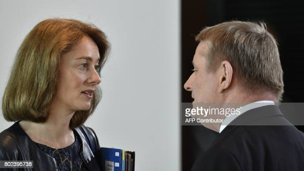 German Health Minister Hermann Groehe and German Family Minister Katarina Barley talk prior to the weekly cabinet meeting at the Chancellery in...