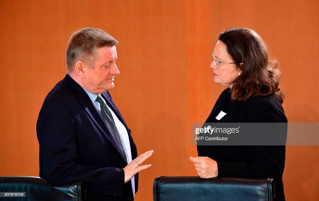 German Health minister Hermann Groehe talks with Labour and Social Minister Andrea Nahles ahead the weekly cabinet meeting in Berlin, on August 23, 2017. /