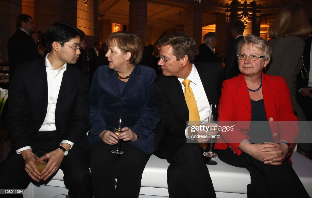 German Health Minister Philipp Roesler, German Chancellor Angela Merkel, German Vice Chancellor and Foreign Minister <a gi-track='captionPersonalityLinkClicked' href=/galleries/search?phrase=Guido+Westerwelle&family=editorial&specificpeople=208748 ng-click='$event.stopPropagation()'>Guido Westerwelle</a> and German Education Minister <a gi-track='captionPersonalityLinkClicked' href=/galleries/search?phrase=Annette+Schavan&family=editorial&specificpeople=599358 ng-click='$event.stopPropagation()'>Annette Schavan</a> attend the 'Long Night of Sueddeutsche Zeitung' on January 12, 2011 in Berlin, Germany.