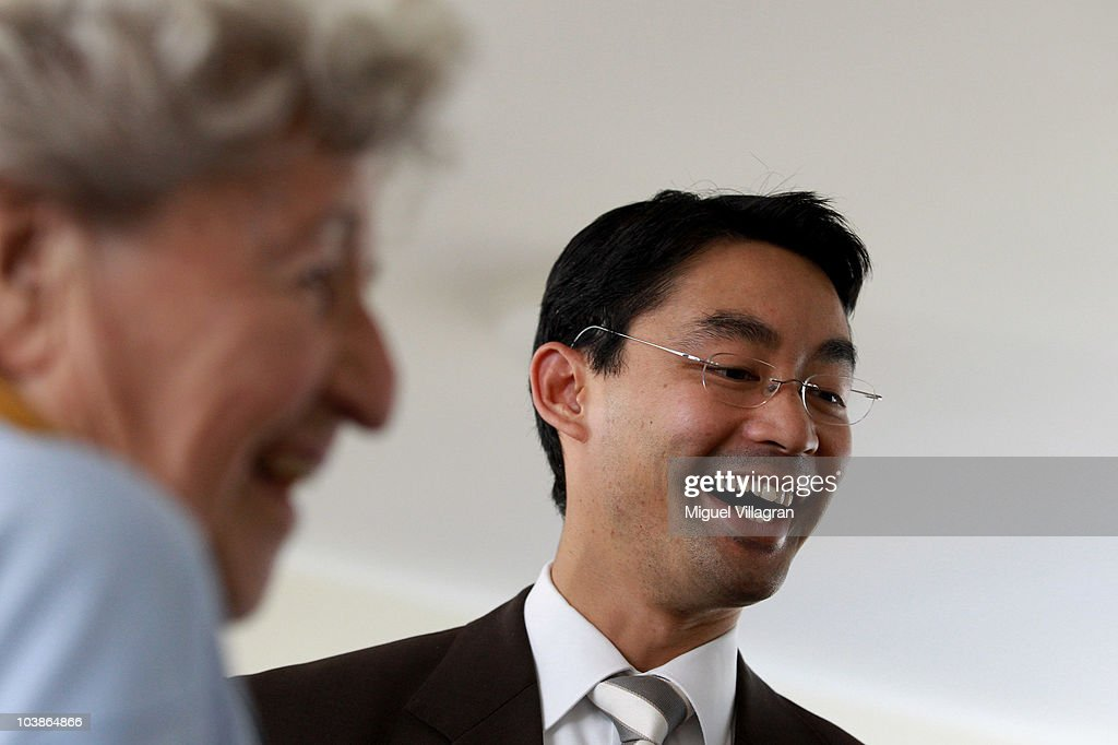 German Health Minister Philipp Roesler (R) laughs as he talks to a woman in an old people's home on September 6, 2010 in Landshut, Germany. Roesler also visited the St.Marien children's clinic in Landshut.