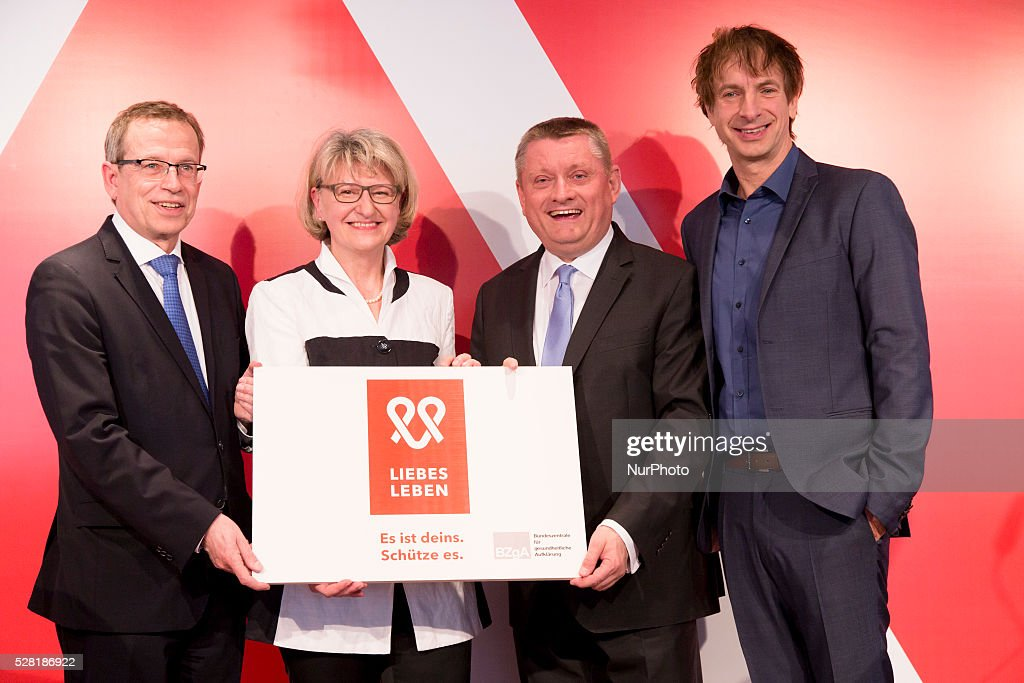 German Heath Minister Hermann Groehe (2R), Actor Ingolf Lueck (R), Director of the Federal Centre for Health Education Heidrun Thaiss (2L) and Director of the Private Health Funds Union Volker Leienbach (L) hold a banner with the logo 'liebesleben' during the launch of a new sensibilisation campaign for prevention from HIV and STDs at the Kalkscheune in Berlin, Germany on May 4, 2016. The campaign is presented from the Federal Centre for Health Education.