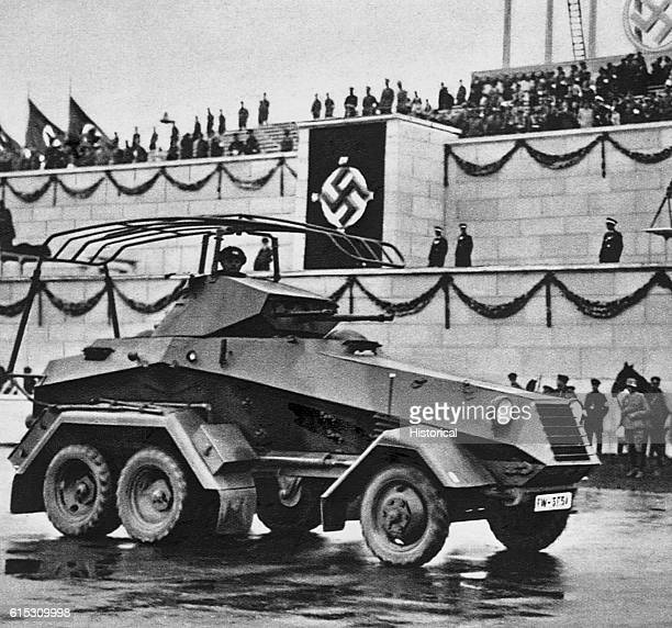 German heavy armored car drives past Nazi onlookers during a rally ca 19391945