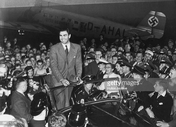 German heavyweight boxing champion Max Schmeling returns to Berlin to a hero's welcome after defeating American boxer Joe Louis in New York 27th June...