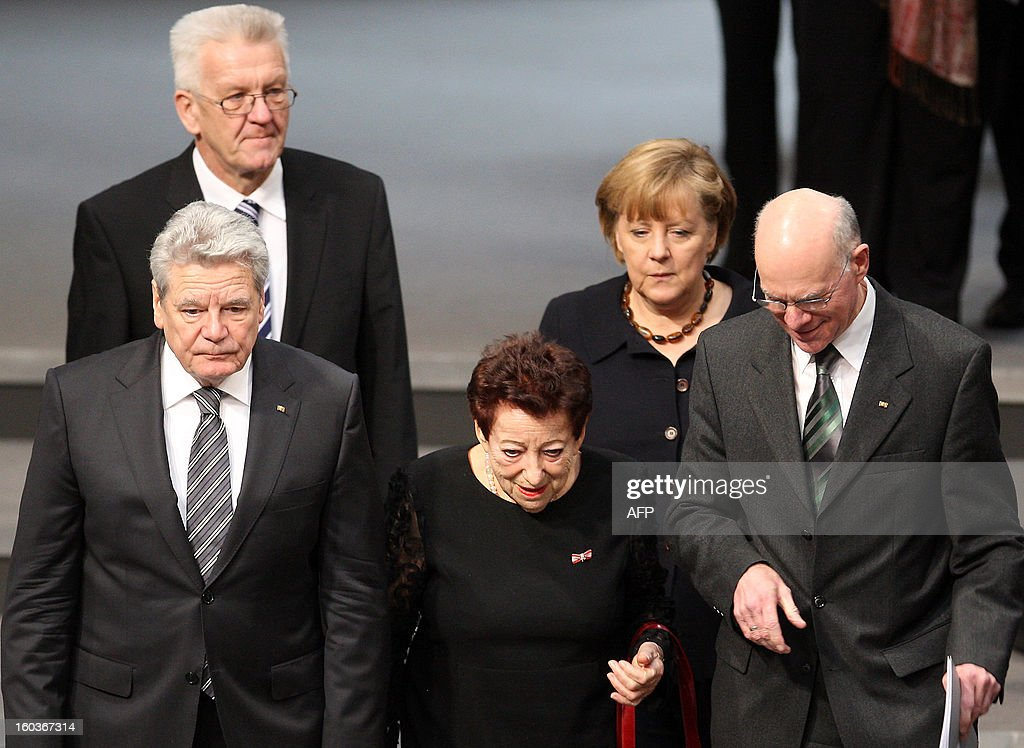 German higher house of Parliament Bundesrat President Winfried Kretschmann (up L) arrives with German Chancellor Angela Merkel (up R), (bottom from L) German President Joachim Gauck, German-Israeli writer Inge Deutschkron and German Bundestag President Norbert Lammert at the German lower house of Parliament Bundestag, in Berlin on January 30, 2013 prior to a memorial to be held by deputies for the victims of the Nazi regime, and the anniversary of the liberation of Auschwitz concentration camp on January 27, 1945. Since the date fell on a Sunday this year, the event was held later, on the day marking 80 years since Adolf Hitler became chancellor. BERRY