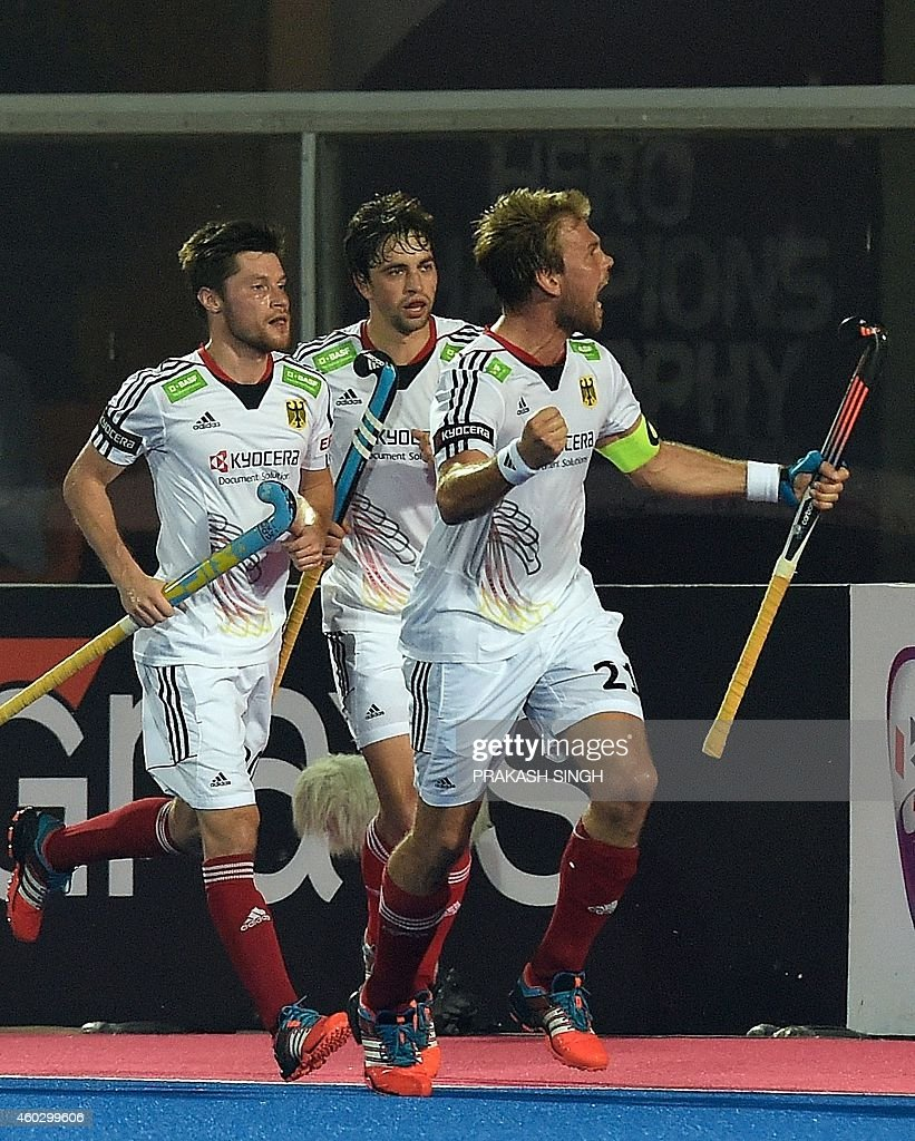 German hockey captain Moritz Furste (R) celebrates a goal against England with teammates during their Hero Hockey Champions Trophy 2014 quater final match at Kalinga Stadium in Bhubaneswar on December 11, 2014. AFP PHOTO/ Prakash SINGH