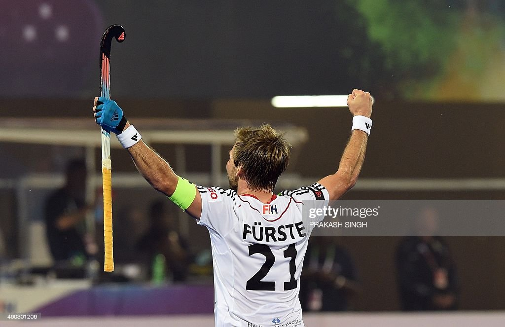 German hockey captain Moritz Furste celebrates victory over England during their Hero Hockey Champions Trophy 2014 quarter final match at Kalinga Stadium in Bhubaneswar on December 11, 2014. AFP PHOTO/ Prakash SINGH