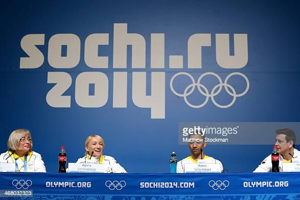 German Ice Skating Union vice president Elke Treitz pairs ice skaters Aljona Savchenko and Robin Szolkowy of Germany and coach Ingo Steuer attend a...