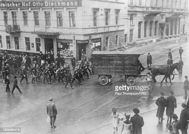 German infantry escort a coal cart through Dortmund in Germany during an industrial strike circa 1905
