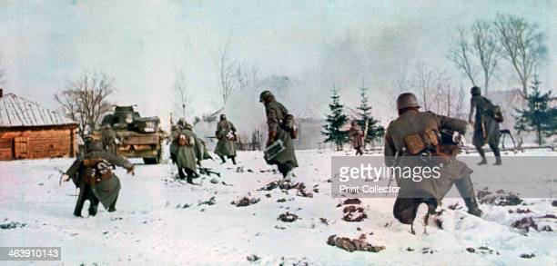 German infantrymen following a tank towards Moscow in the snow Russia 1941 Hitler launched the invasion of the Soviet Union Operation Barbarossa in...