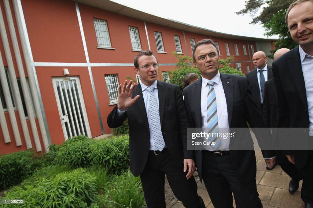 German Interior Minister <a gi-track='captionPersonalityLinkClicked' href=/galleries/search?phrase=Hans-Peter+Friedrich&family=editorial&specificpeople=7528072 ng-click='$event.stopPropagation()'>Hans-Peter Friedrich</a> (C), accompanied by Bundestag member Jan-Marco Luczak (L) and Berlin Senator for Jutsice and Consumer Protection Thomas Heilmann, tours the expanded youth arrest facility in Lichtenrade district on May 9, 2012 in Berlin, Germany. The facility accomodates young men and women first-time offenders for short periods of time with the intent of giving them an impression of what prison is like yet to also give them a second chance at returning to freedom.
