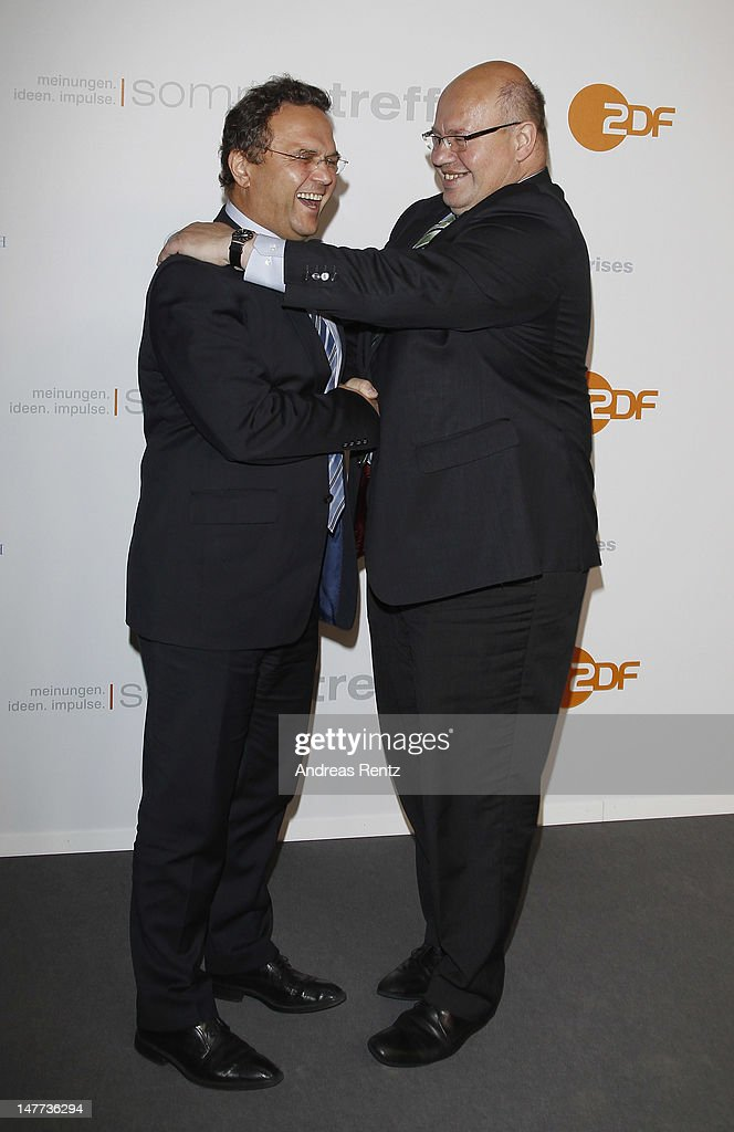 German Interior Minister HansPeter Friedrich and German Environment Minister Peter Altmaier attend the ZDF summer reception on July 2 2012 in Berlin...