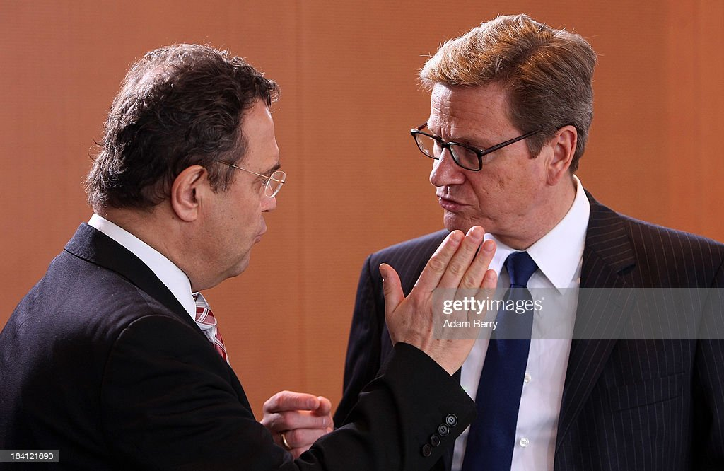 German Interior Minister <a gi-track='captionPersonalityLinkClicked' href=/galleries/search?phrase=Hans-Peter+Friedrich&family=editorial&specificpeople=7528072 ng-click='$event.stopPropagation()'>Hans-Peter Friedrich</a> (L) and German Foreign Minister <a gi-track='captionPersonalityLinkClicked' href=/galleries/search?phrase=Guido+Westerwelle&family=editorial&specificpeople=208748 ng-click='$event.stopPropagation()'>Guido Westerwelle</a> arrive for the German federal Cabinet meeting on March 20, 2013 in Berlin, Germany. High on the morning's agenda was discussion of proposed laws pertaining to preventative health measures as well as the proposed ban on the right-wing National Democratic Party (Nationaldemokratische Partei Deutschlands, or NPD), which, contrary to a joint bid by Germany's 16 states, the federal government has not supported.