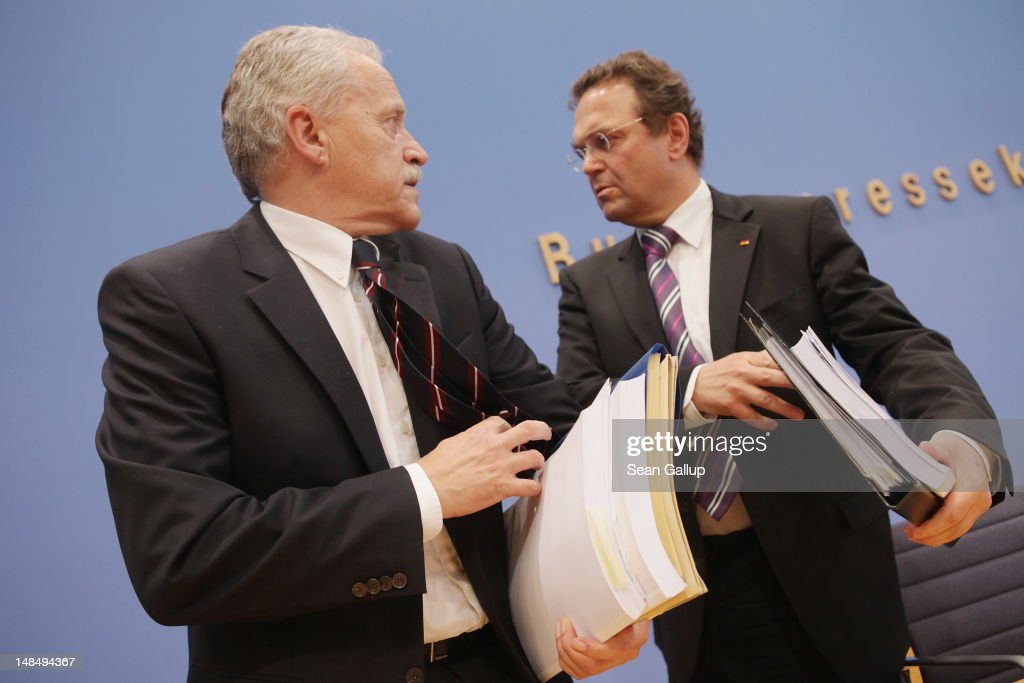 German Interior Minister HansPeter Friedrich and outgoing president of the Federal Office for the Protection of the Constitution Heinz Fromm depart...