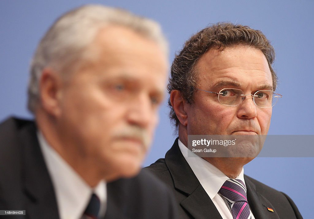 German Interior Minister HansPeter Friedrich and outgoing president of the Federal Office for the Protection of the Constitution Heinz Fromm speak to...